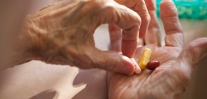 23 Oct 2004 --- Elderly woman dispensing meds Sun City West, AZ - MR --- Image by © Richard Hamilton Smith/Corbis
